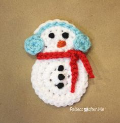 FREE Crochet Snowman Applique Pattern. The perfect embellishment for a hat but would also make a nice ornament or magnet.