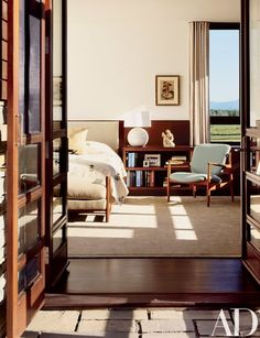 French doors open to the master bedroom. Blanche Lazelle's 1935 watercolor Vase of Flowers hangs above a terra-cotta figure and a Finn Juhl armchair. Double Doors Interior, Interior Barn Doors, Palazzo, French Doors Patio, Modern Ranch, Home Decor Bedroom, Master Bedroom, Bedroom Ideas, Queen