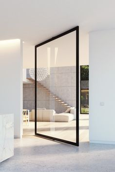 Elegant glass pivot door system made from anodised aluminium. The invisible pivot hinge is completely integrated in the frame and can be mounted on any solid surface.   Portapivot offers made-to-measure hardware for pivot doors, sliding doors and fixed glass partitions.  Our products are shipped wordwide! Only the glass sheet needs to be sourced locally.