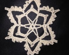 Flurry up your holiday home with these fun, pretty crocheted snowflakes while chasing away those winter blues! Custom made in winter white with 100% cotton crochet thread, a gold-thread loop for hanging, and love! (Unless otherwise specified, they will be made in winter white...please convo me if you would like different color(s) as listed and pictured in photograph #5--NOTE: colors may vary slightly according to monitor resolution) Perfect item for Christmas tree or gift box/bag…