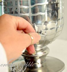 Mercury Glass Vase: draw on vase with Elmer's Glue, spray paint, dry, then pull off glue.