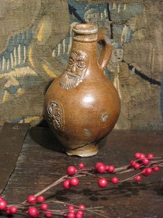 """17TH CENTURY BELAMINE JUG.    OLD CHIPS TO RIM, HANDLE AND BASE.  9"""" HIGH."""