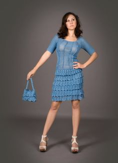 Blue crochet dress with crochet handbag