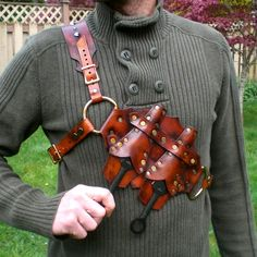 Assassins Knife Holster. I would wear this to renfest, with the handles sticking out, and pull them out like a ninja.....and they would be a fork and spoon :)