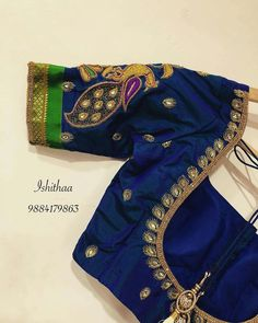 Beautiful designer blouse with peacock design hand embroidery thread work on sleeve. Simple thread work blouse custom made at Ishithaa design house for a sweet client from the US ! Ping on 9884179863 to book an appointment . 06 May 2018 Peacock Blouse Designs, Saree Blouse Neck Designs, Simple Blouse Designs, Stylish Blouse Design, Wedding Saree Blouse Designs, Peacock Design, Blouse Patterns, Simple Designs, Hand Work Blouse Design