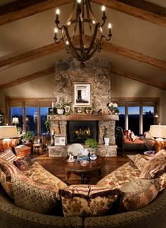 Fireplace - would stop it at the mantle and not go to the ceiling, though and instead of a picture above the fireplace i would do a big tv. I wouldn't have the couch like that though; I would do one in the back and one more on one of the sides with one rocker on the other side.