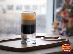 On the third day of Kahlua Holiday serve up the three layers of a B-52!  Layer in a shot glass: 1 part Kahlua 1 part Irish cream liqueur 1 part Orange liqueur