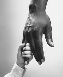 Dorthea Lange - i thought this was nice. the different races holding hands showing solidarity. its a nice photo because they are the only things in frame, there is negative space behind them, which emphasises the contrast