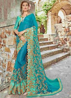 Shop for handmade indian sarees online! Order this faux chiffon embroidered and patch border work classic designer saree for party and wedding.