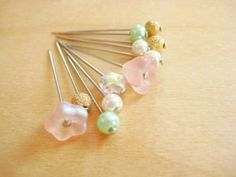glass beads glued to straight pins.  Mom is always looking for small earrings for her dolls she makes.  Perfect idea!
