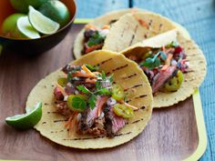 Marinated Skirt Steak Tacos with Pecan-Chipotle Salsa | Chefs Roberto Santibañez and April Bloomfield create fun tacos, like this grilled steak one with a spicy-smoky salsa, at Salvation Taco in NYC.