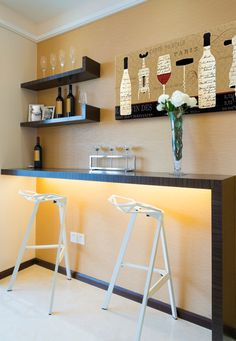 In-house mini bar area. Floating shelves, clean, geometric bar, and warm colors. Boom.