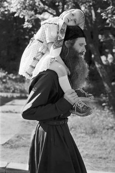 orthodoxwayoflife:    A monk and a little girl.