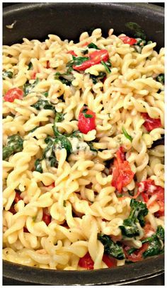 FUSILLI PASTA with SPINACH, TOMATOES, ASIAGO & PARMESAN CHEESE (Chef Giada De Laurentiis recipe) - Wonderful pasta dish that is light and delicious...simple to make too. With over 380 reviews and a 5 star rating, this is a recipe I plan on making time and time again, my family loved it, including the kids! | SweetLittleBluebird.com