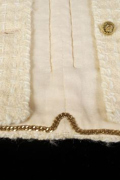 Gabrielle 'Coco' Chanel; French, 1960s; Detail of the lining from from yellow wool suit. More