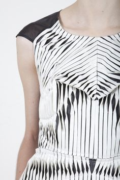 Dutch designer Kirsten Enkelmann - I love how the white tucks have been stitched across the reveal the darker fabric beneath.