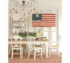 This American flag really stands out in this white dining area
