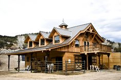 This custom barn home built by DC Building in Taos, NM has 4 stalls, living quarters, a tack room with 1/2 bath, and solar powered radiant heat in the slab.