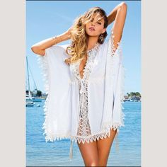 """Feel like royalty in this gorgeous crochet cover up by Sun Kitten Swimwear. The """"Heiress"""" beach cover up is so luxurious it should be on every girls wish list this season! The crochet and lace details make this summer dress very feminine and flirty. Take this look from the sand to the streets with just a simple pair of nude wedge shoes, and you'll be ready to hit the shops in style."""