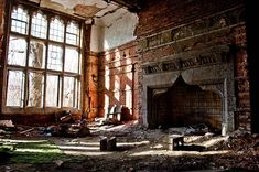 Interior of an abandoned house. Look at that fireplace!