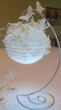 "Paper lanterns decorated with silk flowers, lots of ""sparkle"" and glow with LED lights! によく似た商品を Etsy で探す"
