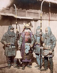 Samurai in traditional armor and three retainers wearing kusari katabira (chain armor jackets) and hachi-gane (forehead protectors).