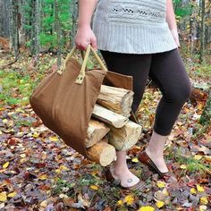 """Open End Log Carrier - Brown.   If you need about two armloads of wood in a hurry, the Open End Log Carrier is here to help you meet that need. Measuring 16 1/2"""" Wide x 36"""" High, you can get the wood you need without having to make a bunch of trips! This carrier is made from durable canvass that is very strong and very lightweight. #logcarrier #firewood #carrier"""