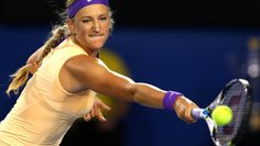 Victoria Azarenka of Belarus plays a backhand in her women's final match against Na Li of China during day thirteen of the 2013 Australian Open at Melbourne Park on January 26, 2013 in Melbourne, Australia. / QUINN ROONEY/GETTY IMAGES