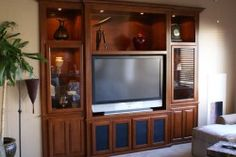 Custom entertainment center built into wall niche