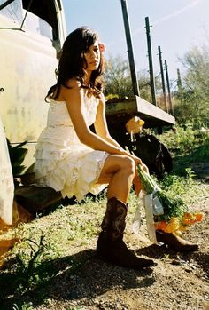 Good inspiration for a cowgirl wedding. The short wedding dress looks so chic with the classic western brown boots. And the pop of yellow in the bouquet? Short Country Wedding Dress, White Wedding Dresses, Wedding Gowns, Lace Wedding, Wedding Vintage, Wedding Rustic, Gypsy Wedding, Wedding Simple, Bridal Gowns