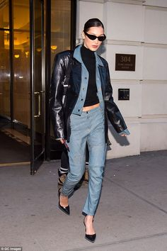 On the go: Yolanda's daughter Bella, 21, was also spotted running errands of her own Monday in the Big Apple