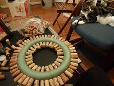 With years of wine corks saved up we finally got around to doing something with them, and it turned out great! In previous cork projects, we. Wine Cork Candle, Wine Cork Wreath, Wine Cork Ornaments, Wine Cork Art, Wine Bottle Candles, Wine Cork Crafts, Wine Bottle Crafts, Wine Corks, Wine Cork Projects
