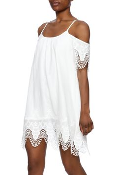 White sundress with lace detailingspaghetti straps round neckline and short off the shoulder sleeves.  The Ella Sundress by Ellison. Clothing - Dresses - Casual Clothing - Dresses - Short Sleeve Minneapolis Minnesota