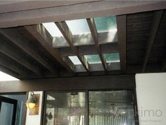 an existing wood deck and wished to install glass flooring panels to allow light to filter through to the dark space below