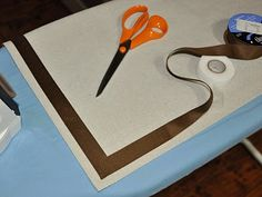 Tutorial on making a canvas curtain.. could adjust for breakfast room window