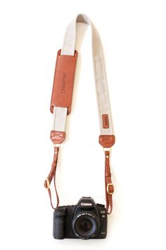 Stone Fotostrap: Camera Strap That Gives Back. Classic color of Khaki, genuine leather with custom monogram!