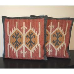 @Overstock.com - Tribal Indo Kilim Pillows (Set of Two) - Add a splash of color and comfort with these unique kilim pillows that are hand-crafted in India. These two pillows are made with flat woven jute and have an attractive geometric design that represents world art. The neutral colors match most decor.  http://www.overstock.com/Worldstock-Fair-Trade/Tribal-Indo-Kilim-Pillows-Set-of-Two/7294781/product.html?CID=214117 $59.99
