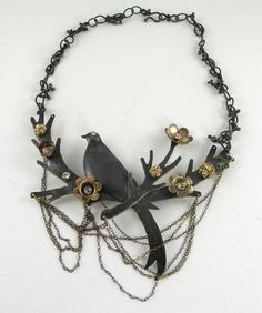 Elsa Mora: I made this necklace out of antiqued sterling silver and gold filled. I also used some crystals. I named it The Jungle.