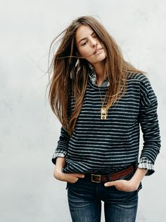 striped sweater over shirt