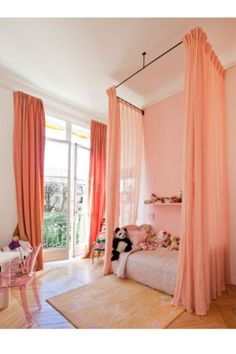 Love how the drapes are hung around the bed.  Good way to add height and drama to your bedroom.