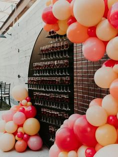 Champagne welcome wall at wedding reception with pink and orange balloon arch Rainbow Wedding Decorations, Rainbow Wedding Dress, Wedding Reception Decorations, On Your Wedding Day, Dream Wedding, Orange Balloons, Dinner Party Table, New Years Eve Weddings, November Wedding
