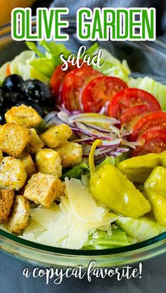 This Olive Garden salad recipe is a copycat of the restaurant favorite with lettuce, tomatoes, olives, onion and croutons, all tossed with a creamy Italian dressing.