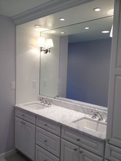Custom Bathroom Vanities Oakville double sink bathroom vanity with dividing storage cabinet | tile