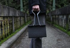 If you like unordinary things and want to be unique then this playful Clip Bag is for you. It borrows its form from a common office item – the binder clip. Constructed of wool felt.