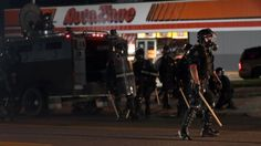 Riot breaks out, store burned