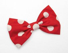 A beautifully made classic style hair bow clip. I love hair bows! They are the cutest hair accessory. You can clip your bow and create so many different looks. Wear it with your hair in a cute bun, loose hair, your hair half up, its endless! Red with White Polkadots print. Bow Style: Classic Bow. Measures approximately: 5 inches by 3 inches. Fits: Women, Teens and Girls. This listing is for 1 handmade hair bow.