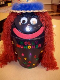 Literacy Centers - Molly Muncher is just a trash can from the $ store the teacher decorated.  The students can feed Molly anything i.e. cards with letters, pictures, numbers, etc... but they must tell Molly what she is eating before they feed her.