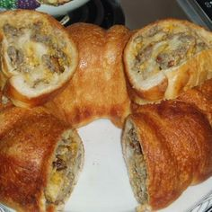 Sausage/Cheese Bread Roll - This sounds like my kind of breakfast. Meaty, spicy, covered with bread :)