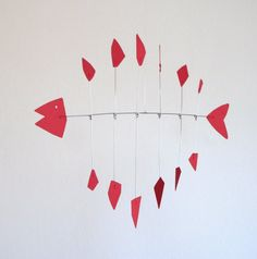 Kinetic Redfish is a smaller scale, suspended metal sculpture with a light, playful appearance. The piece is kinetic in that the fins move and