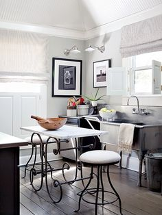 Love this marble top wrought iron table with the wooden salad bowl atop